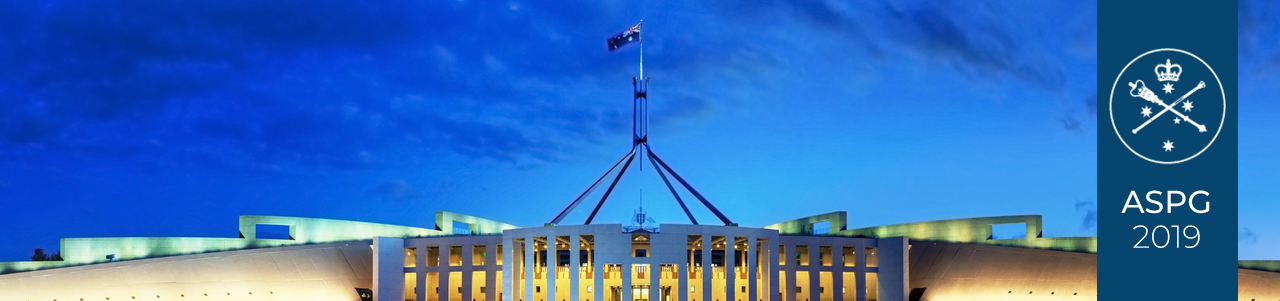 Australian federal parliament facade lit up at dusk